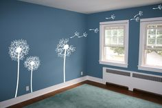 dandelion decals. Love the white decals against the blue walls. Really makes the room pop