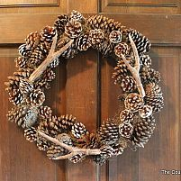 The completed wreath with the faux antlers and pinecones.  http://www.thecountrychiccottage.net/2012/10/pottery-barn-knock-off-faux-antler.html