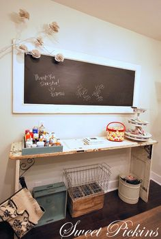 Wonderful side table made from an old door (or two?) and metal brackets. Also like the chalkboard - a single panel door with the frame painted white and the interior painted with chalkboard paint.
