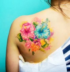 Morning Glory watercolor tattoo on girl's shoulder. Flower Watercolor tattoo