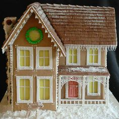 My Old Kentucky Home. This was made using a classic Victorian gingerbread blueprint. Jelly candy rocks make up the chimney, and chocolate fondant with corn starch snow make up the roof. Yellow edible paper creates the glowing windows. From This Old House's Editors' Picks: 99 Amazingly Crafted Gingerbread Houses