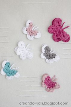 Crocheted butterflies  would look so cute on the shoulder strap of one of Isabella's dresses