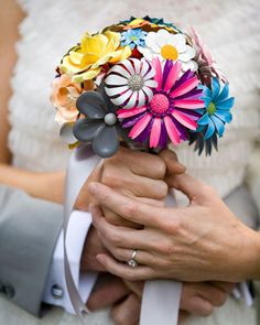 This bride fashioned her collection of bright vintage enamel-flower brooches into a bouquet