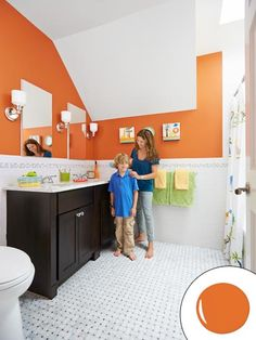 Timeless finishes plus a punchy paint color give a children's bath room to grow   Paint: 2168-20 Pumpkin Cream (walls) and PM-19 White Dove (ceiling and trim); @benjamin_moore   Photo: Mark Lund