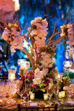 Manzanita centerpieces dripping with orchids