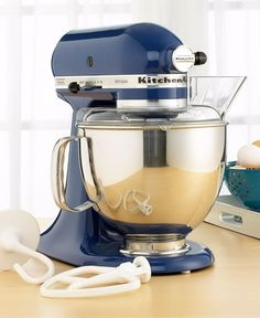 KitchenAid KSM150PS Stand Mixer, 5 Qt. Artisan in blue willow. While that pistachio colored mixer certainly is fetching, I should probably go for a match w/ the Kitchenaid we already have...