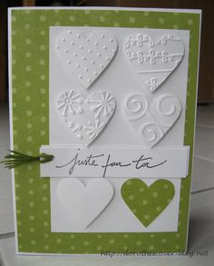 lovely card with punched hearts ... like how the different embossing folder designs are placed inside the hearts ...