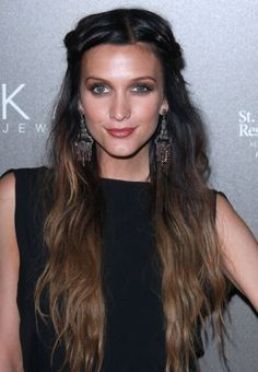 In Los Angeles, Ashlee Simpson wore this long Rapunzel-like hairstyle to the Neil Lane Jewelry Launch. Ashlee Simpson looked like she could have stepped out of a renaissance fair with her long locks and braided sides pulled back. Chandelier earrings completed the romantic hairstyle.