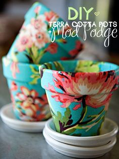 All you need is Mod Podge, fabric, and terra cotta pots.  I can't wait to do this!!