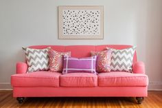 I love the simplicity of the art above the sofa; and now I am wondering why I don't have a coral sofa?   http://www.caitlinwilsontextiles.com/?p=collection
