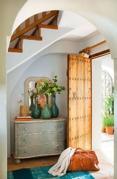rustic distressed chest, trio of green vases, louis phillipe mirror, over dyed rug