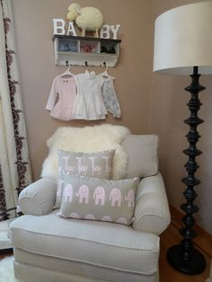 Embrace Space #EssentialEmbrace Nursery - baby clothes on hooks
