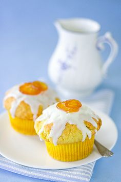 Sunny hued, cheerfully inviting Orange Muffins with Lemon Glaze and Candied Kumquats. #muffins #dessert #food #breakfast #brunch #orange #fruit