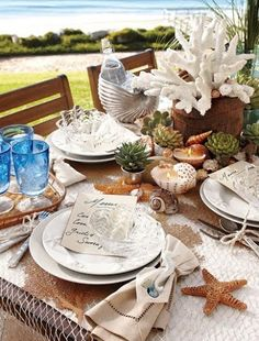 Decorative Fish Net as a Summer Tablecloth-remember to add some shells for a special touch!
