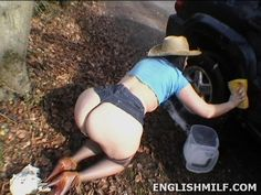Big butt voluptuous British woman in booty shorts, stockings and heels washing her car on all fours in public. Ladies with big butts women big big bottoms.