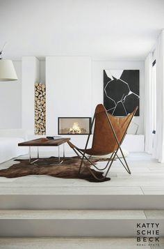 black and white painting in a modern living room. #Modern #Art #Home #Decor #Wood #Hide