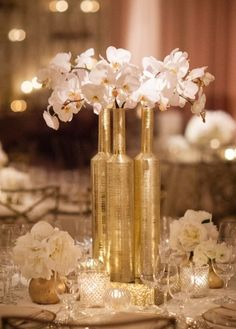 Pretty gold bottle vases and flowers...wonderful for a 50th golden wedding anniversary