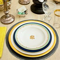 Edgy Thanksgiving Table | Balance a whitewashed table with graphic hits of black and navy, such as black candles and leather chairs, slate-gray woven place mats, and navy-rimmed dinner plates. | SouthernLiving.com