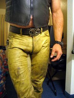Yellow leather pants, big belt buckle