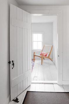 """We love the all-white floors and walls of the third floor. It feels like the perfect little beach cottage up there."""