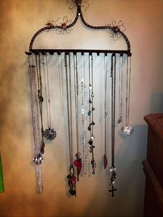 DIY necklace holder made out of an old rake :)