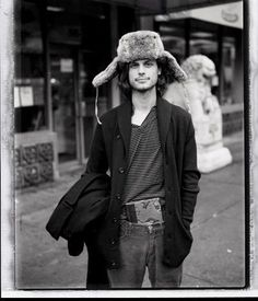 Matthew Gray Gubler with a hat on his head and a book in his pants.