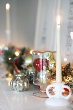 Fill glass hurricanes with ornaments for an easy focal point on your mantel or fireplace.
