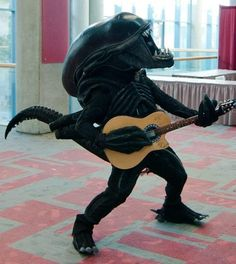 An Alien playing a guitar. Your argument is invalid.