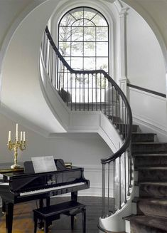 Gorgeous staircase. Love the piano in the entry. Austin Patterson Disston Architects.
