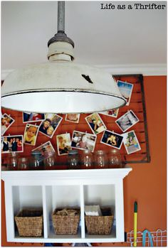 Love this idea for using an old crib box spring to display a collection of photos. Use mini clothespins or office clips to attach the photos.