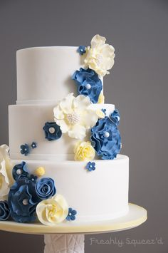 White, butter yellow and periwinkle blue wedding cake, with lemon buttercream and lemon curd.  Top tier was gluten free for the bride and her brother.