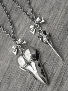 Bird Skull & Bow Necklaces by InkandRoses13