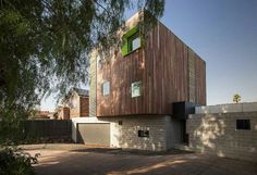 Nice splash of color-- Australian architecture studio M.O.D.O designed this brilliant modern home which surrounds a central landscaped backyard in Aberfeldie, Victoria.