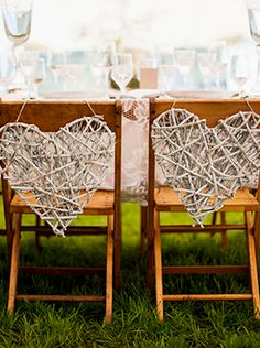 Wedding idea: his and her hearts on the bride and groom chairs.
