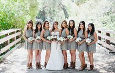 Bridesmaids in gray dresses and leather boots.  Unique!