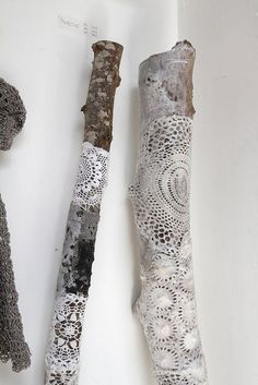 now that's a different way to use lace - on a branch...but quite interesting