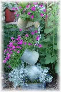 Love this idea! Recycled garden art~
