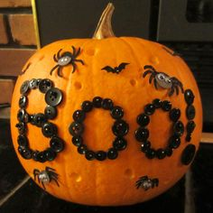 Raid your sewing box for this boo-tastic pumpkin idea.  Pumpkin and photo courtesy of Busted Button | thisoldhouse.com