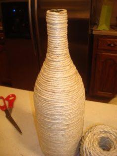 Glue twine or yarn to an empty wine bottle