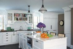 Eclectic, sleek white kitchen