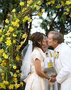 Yellow Daffodil Arch   - Katie: or have a big heart wreath for people to put daffodils into - backdrop during ceremony - then can use for photo booth at the reception!!