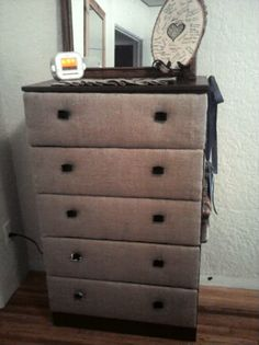 Burlap fronted chest of drawers.