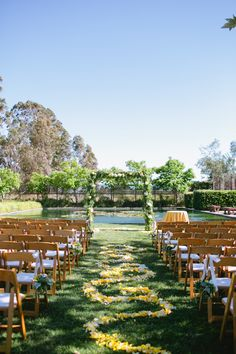 Outdoor Ceremony - with yellow petals down the aisle -- pretty! More on SMP: http://www.StyleMePretty.com/california-weddings/2014/05/30/music-inspired-sonoma-wedding/ Photography: JennaMariePhoto.com