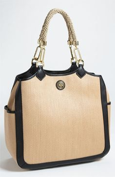 Tory Burch- I'm not much of a Tory Burch fan, bit this is a good-looking handbag.
