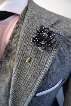 white dot lapel flower
