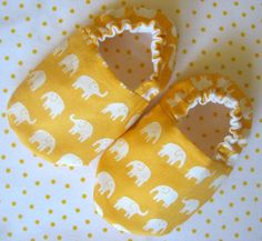I bought my girl some baby shoes in this same style from etsy (yes, with elephants on them), but I LOVE them even more in the yellow and white.
