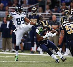 Trumaine Johnson intercepts a pass intended for Doug Baldwin, left. It was the first of three interceptions Seahawks quarterback Russell Wilson threw in St. Louis in a 19-13 loss. (Photo by John Lok / The Seattle Times)