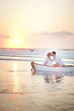 Such a sweet moment between the bride and groom... sharing a kiss during the sunset on their wedding day! Love it!