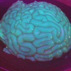 Glow in the black light Jell-O brains. Use a brain mold and substitute one part tonic water.