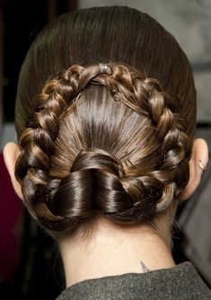 We've dubbed this the 'horse-shoe braid' because of it's shape. Ponytail into braid. Love it!